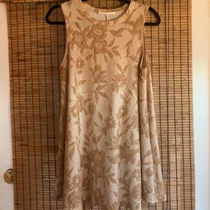 Gold babydoll dress with floral detail